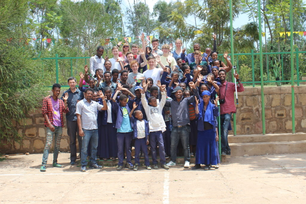 St Paul's College group with members of the local community in Ambo, Ethiopia 2017